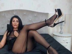 Gorgeous brunette MILF masturbating in high heels