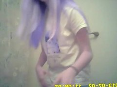 Pink haired teen changing clothes in the bathroom
