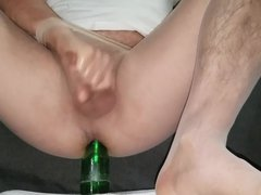 Fucking bottle through seamless hose with cum