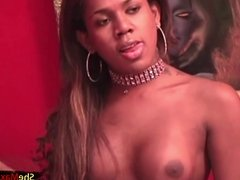 Black chick with dick shows off her fuckable ass and shecock