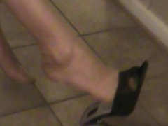 dangling heels off of  stockingb feet