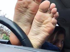 girl show feet in car 3