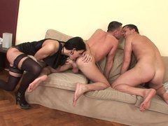 Bisexual hunks fuck a slut in stockings and each other
