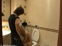 Hot gal sucks cock in a toilet