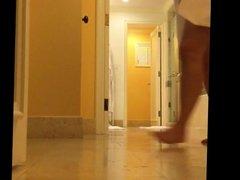 unaware MILF caught on hotel bathroom hidden cam