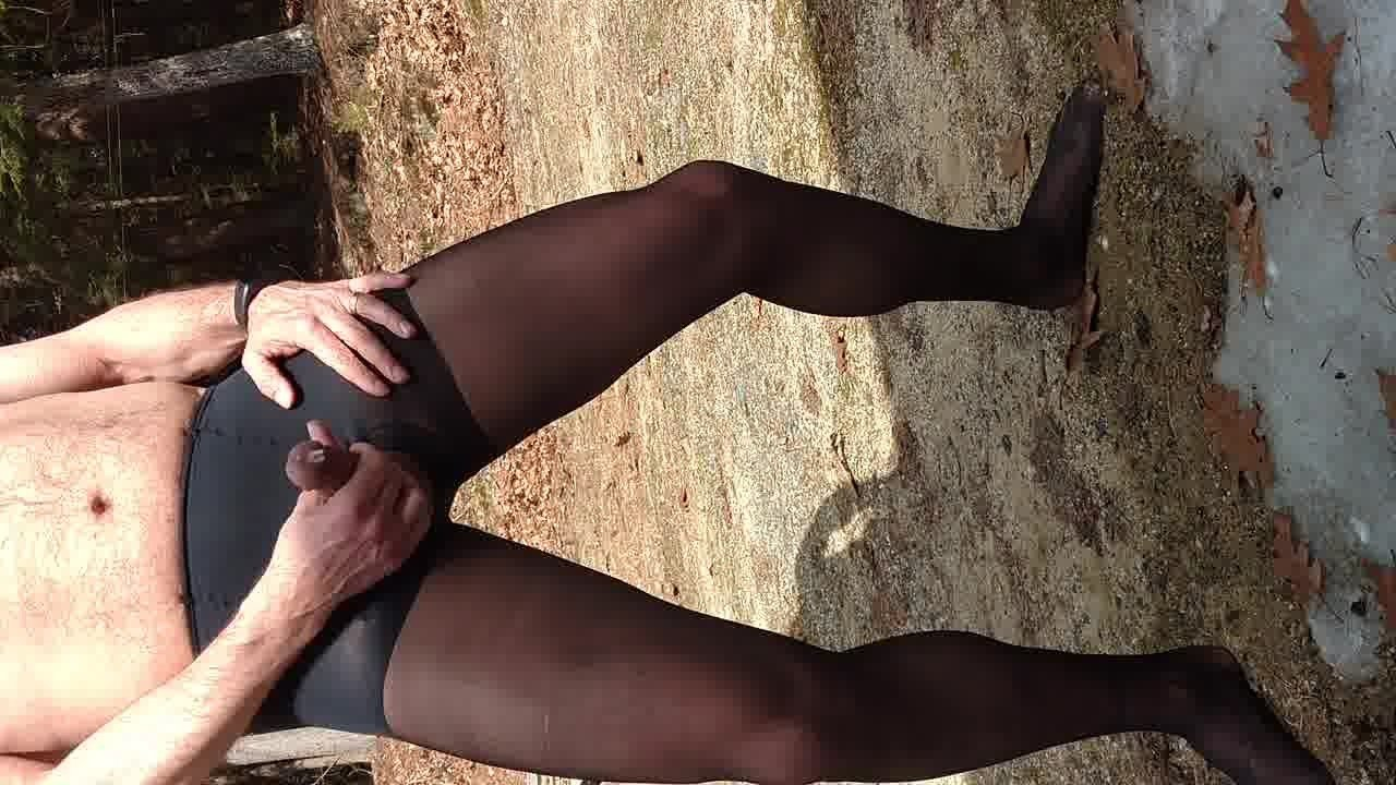 Jerking off outside in black pantyhose