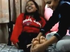 Indian girl getting her feet tickled