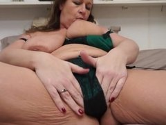 British MILF with big tits playing with herself