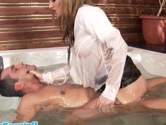 Busty Abbie Cat rides cock in jacuzzi
