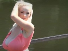 Big boobs walking by a river