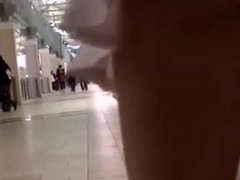 Teen walking in mall with vibrator