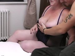 Busty blonde in lingerie riding cock