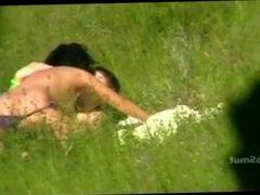 having sex on the grass