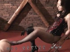 Mistress commits from behind with a dildo to the slave