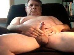 A older man masturbating in armchair