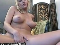 Busty amateur Lisa masturbates in the couch