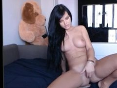 Black haired goddess strips and plays with herself
