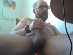 Mature guy shoots his load with a dildo up his ass