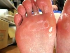 Japanese girl sniffs, and licks her sweaty feet...