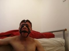 Paddling My balls while Wearing Nipple Clamps and a Ballgag Harness