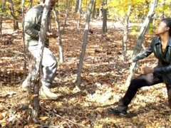 woman fight man in the forest