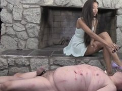 Naughty great looking mistress enjoys punishing her fat male foot slave