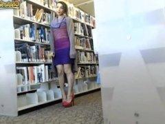 Big tits girl flashing on library