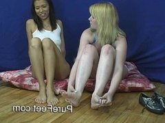 MILF and Asian girl smell each other's feet