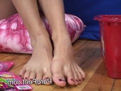 Asian girl plays with her feet and toes