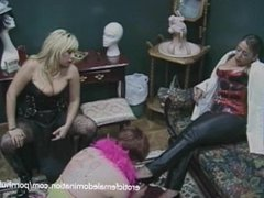Two chubby harlots dress up a stud and get their boots licked