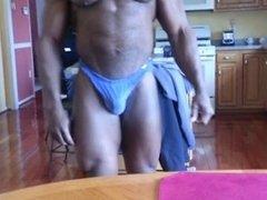 Mature Black Bodybuilder Posing in Kitchen