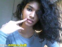Sexy Ebony teen with curly hair teasing
