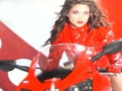 girl in red leathers screwed on bike
