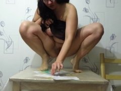 mature brunette with big tits peeing on the table