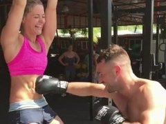 Hot Blonde with Rock Hard Abs Laughs at Belly Punching Male