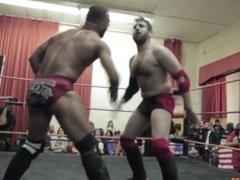 A Gangone KOs stud Ricochet with a neck breaker across his knee (no sex)