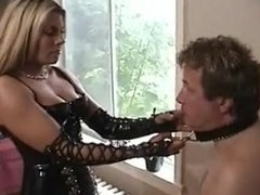 Mistress Elektra Skye pinches the nipples of her slave