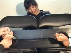 Japanese Girl Tickled in Stocks with Black socks and Bare Feet