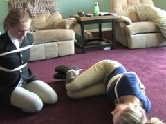 2 girls tied up in riding boots