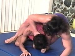 woman lift and wrestle skinny guy