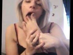 Girl licks her own feet