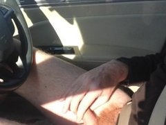 stroking cock while driving