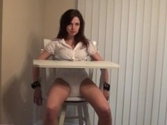 diaper girl strapped to high chair