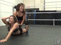 2 girls wrestling in socks