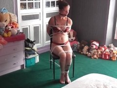 Sandy chairtied in lingerie. See full version with cleavegag :)