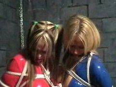 Lucy Zara & Jane W in latex bondage