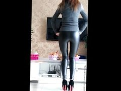Chinese girl showing off her new shiny pants