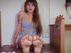Ladyboy footlover teasing with red toenails