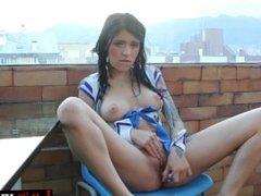 Hot teen masturbating on the balcony