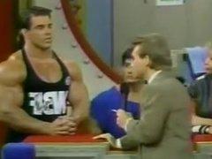 Bodybuilders flexing on game show